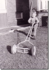 Charles mowing lawn May 1953